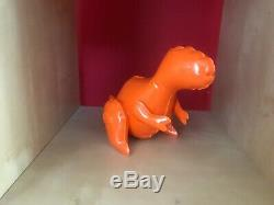 Brett Kern orange ceramic t-Rex dinosaur sculpture